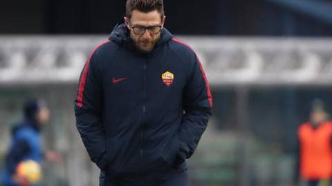 Roma coach Eusebio di Francesco looks down during the Serie A soccer match between Cheivo Verona and  AS Roma at the Bentegodi stadium in Verona, Italy, Sunday, Dec. 10, 2017. (Simone Venezia/ANSA via AP)