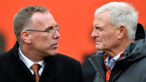 Cleveland Browns general manager John Dorsey talks with owner Jimmy Haslam before an NFL football game between the Green Bay Packers and the Cleveland Browns, Sunday, Dec. 10, 2017, in Cleveland. (AP Photo/David Richard)