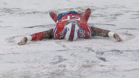Buffalo Bills' Ryan Davis makes a snow angel on the field before an NFL football game between the Buffalo Bills and the Indianapolis Colts, Sunday, Dec. 10, 2017, in Orchard Park, N.Y. (AP Photo/Seth Wenig)