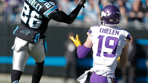 Carolina Panthers' Daryl Worley (26) intercepts a pass intended for Minnesota Vikings' Adam Thielen (19) during the first half of an NFL football game in Charlotte, N.C., Sunday, Dec. 10, 2017. (AP Photo/Bob Leverone)