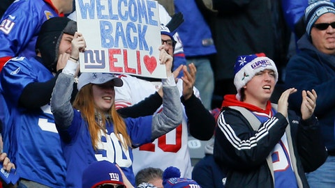 New York Giants fans hold up a sign for New York Giants quarterback Eli Manning (10) during the first quarter of an NFL football game against the Dallas Cowboys, Sunday, Dec. 10, 2017, in East Rutherford, N.J. (AP Photo/Adam Hunger)