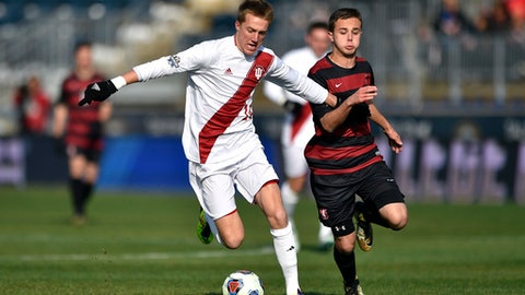 Indiana Hoosiers' Griffin Dorsey, left, dribbles the ball past Stanford Cardinal' Jared Gilbey during the first half of the NCAA College Cup championship soccer match, Sunday, Dec. 10, 2017, in Chester, Pa. (AP Photo/Derik Hamilton)
