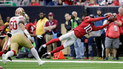 Houston Texans wide receiver DeAndre Hopkins (10) stretches out to make a catch against the San Francisco 49ers during the first half of an NFL football game, Sunday, Dec. 10, 2017, in Houston. (AP Photo/Michael Wyke)