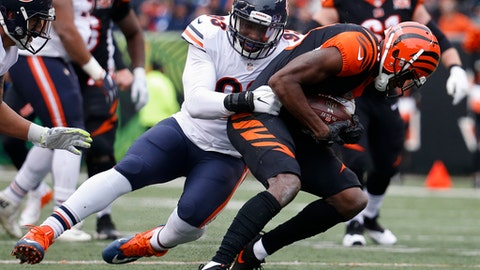 Chicago Bears outside linebacker Sam Acho (93) tackles Cincinnati Bengals wide receiver A.J. Green, right, in the first half of an NFL football game, Sunday, Dec. 10, 2017, in Cincinnati. (AP Photo/Frank Victores)