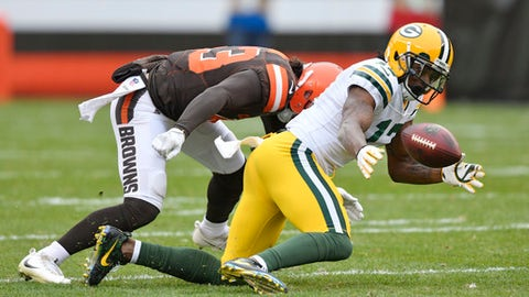 Green Bay Packers wide receiver Davante Adams (17) can't hold onto the ball under pressure from Cleveland Browns linebacker Kai Nacua (43) in the first half of an NFL football game, Sunday, Dec. 10, 2017, in Cleveland. (AP Photo/David Richard)