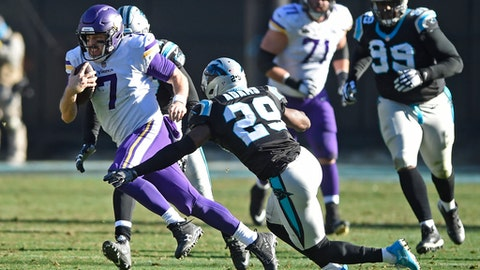 Minnesota Vikings' Case Keenum (7) runs as Carolina Panthers' Mike Adams (29) defends during the first half of an NFL football game in Charlotte, N.C., Sunday, Dec. 10, 2017. (AP Photo/Mike McCarn)