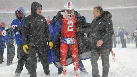 Buffalo Bills quarterback Nathan Peterman, center, is helped to the sidelines during the second half of an NFL football game against the Indianapolis Colts, Sunday, Dec. 10, 2017, in Orchard Park, N.Y. (AP Photo/Adrian Kraus)