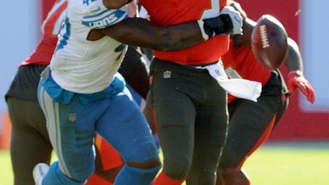 Tampa Bay Buccaneers quarterback Jameis Winston (3) fumbles when he is hit by Detroit Lions linebacker Jarrad Davis (40) during the second half of an NFL football game Sunday, Dec. 10, 2017, in Tampa, Fla. Detroit recovered the fumble. (AP Photo/Steve Nesius)