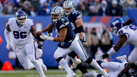 CORRECTS TO COWBOYS QUARTERBACK DAK PRESCOTT NOT ZAC DYSERT - Dallas Cowboys quarterback Dak Prescott (4) runs the ball against the New York Giants during the second quarter of an NFL football game, Sunday, Dec. 10, 2017, in East Rutherford, N.J. (AP Photo/Adam Hunger)