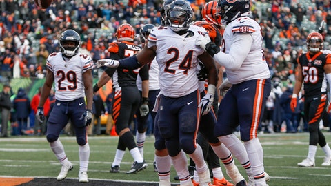 Chicago Bears running back Jordan Howard (24) flips the ball away after scoring a touchdown in the second half of an NFL football game against the Cincinnati Bengals, Sunday, Dec. 10, 2017, in Cincinnati. (AP Photo/Frank Victores)