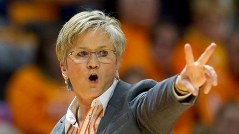 Tennessee head coach Holly Warlick calls to her team in the first half of an NCAA college basketball game against Texas, Sunday, Dec. 10, 2017, in Knoxville, Tenn. (AP Photo/Calvin Mattheis)
