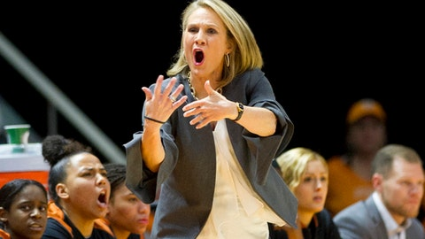 Texas Head Coach Karen Aston calls to her team in the first half of an NCAA college basketball game against Tennessee, Sunday, Dec. 10, 2017, in Knoxville, Tenn. (AP Photo/Calvin Mattheis)