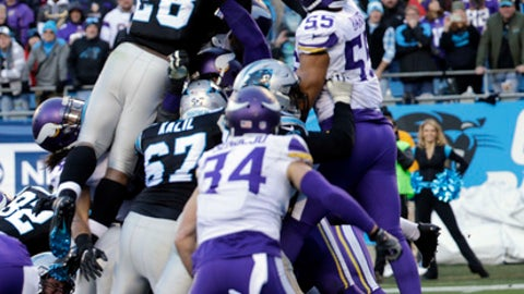 Carolina Panthers' Jonathan Stewart (28) leaps over the goal line for a touchdown against the Minnesota Vikings during the second half of an NFL football game in Charlotte, N.C., Sunday, Dec. 10, 2017. (AP Photo/Chuck Burton)