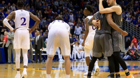 Arizona State guard Kodi Justice, right, hugs guard Remy Martin (1) during the final seconds of an NCAA college basketball game against Kansas in Lawrence, Kan., Sunday, Dec. 10, 2017. (AP Photo/Orlin Wagner)