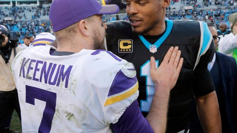 Carolina Panthers' Cam Newton (1) talks with Minnesota Vikings' Case Keenum (7) after an NFL football game in Charlotte, N.C., Sunday, Dec. 10, 2017. (AP Photo/Bob Leverone)