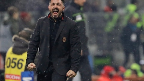 AC Milan coach Gennaro Gattuso celebrates his side's 2-1 win, at the end of the Serie A soccer match between AC Milan and Bologna, at the San Siro stadium in Milan, Italy, Sunday, Dec. 10, 2017. (AP Photo/Luca Bruno)