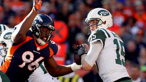 New York Jets quarterback Josh McCown (15) is sacked by Denver Broncos defensive end Shelby Harris (96) during the first half of an NFL football game, Sunday, Dec. 10, 2017, in Denver. (AP Photo/Joe Mahoney)