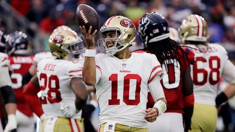 San Francisco 49ers quarterback Jimmy Garoppolo (10) smiles after a play during the second half of an NFL football game against the Houston Texans, Sunday, Dec. 10, 2017, in Houston. San Francisco won 26-16. (AP Photo/David J. Phillip)