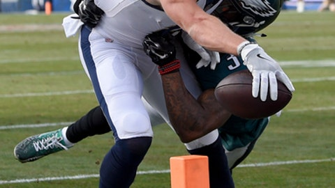 Los Angeles Rams wide receiver Cooper Kupp scores ahead of Philadelphia Eagles cornerback Jalen Mills during the first half of an NFL football game Sunday, Dec. 10, 2017, in Los Angeles. (AP Photo/Mark J. Terrill)