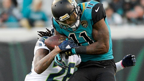 Jacksonville Jaguars wide receiver Marqise Lee (11) makes a reception in front of Seattle Seahawks cornerback Shaquill Griffin during the first half of an NFL football game, Sunday, Dec. 10, 2017, in Jacksonville, Fla. (AP Photo/Phelan M. Ebenhack)