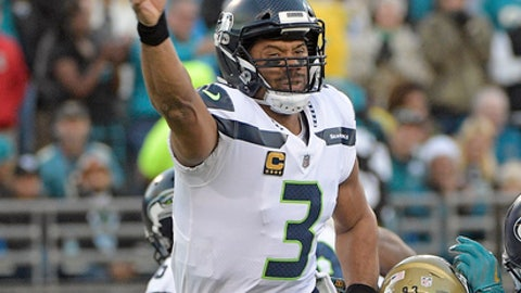Seattle Seahawks quarterback Russell Wilson (3) releases a pass as he is hit by Jacksonville Jaguars defensive lineman Calais Campbell during the first half of an NFL football game, Sunday, Dec. 10, 2017, in Jacksonville, Fla. (AP Photo/Phelan M. Ebenhack)