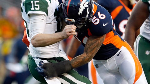 Denver Broncos outside linebacker Shane Ray (56) tackles New York Jets quarterback Josh McCown (15) during the second half of an NFL football game, Sunday, Dec. 10, 2017, in Denver. McCown left the game after the hit. (AP Photo/Joe Mahoney)