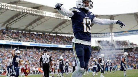 Los Angeles Chargers wide receiver Keenan Allen reacts after a touchdown by teammate running back Melvin Gordon during the second half of an NFL football game against the Washington Redskins, Sunday, Dec. 10, 2017, in Carson, Calif. (AP Photo/Alex Gallardo)