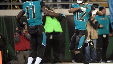 Jacksonville Jaguars wide receiver Dede Westbrook (12) celebrates his touchdown against the Seattle Seahawks with teammate wide receiver Marqise Lee (11) during the second half of an NFL football game, Sunday, Dec. 10, 2017, in Jacksonville, Fla. (AP Photo/Phelan M. Ebenhack)