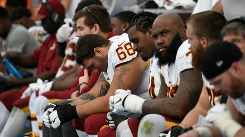 Washington Redskins guard Tyler Catalina (68) reacts as he sits with teammates during the second half of an NFL football game against the Los Angeles Chargers, Sunday, Dec. 10, 2017, in Carson, Calif. (AP Photo/Denis Poroy)