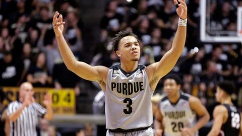 Purdue guard Carsen Edwards (3) celebrates in the first half of an NCAA college basketball game against IUPUI in West Lafayette, Ind., Sunday, Dec. 10, 2017. (AP Photo/Michael Conroy)