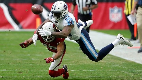 Arizona Cardinals defensive back Tramon Williams (25) breaks up a pass intended for Tennessee Titans wide receiver Corey Davis (84) during the first half of an NFL football game, Sunday, Dec.10, 2017, in Glendale, Ariz. (AP Photo/Rick Scuteri)