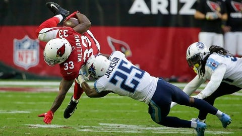 Arizona Cardinals running back Kerwynn Williams (33) gets upended by Tennessee Titans cornerback Adoree' Jackson (25) during the second half of an NFL football game, Sunday, Dec.10, 2017, in Glendale, Ariz. (AP Photo/Rick Scuteri)