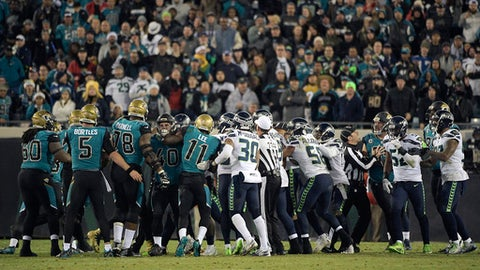 Players from the Jacksonville Jaguars, left, and the Seattle Seahawks get into a scrum during the second half of an NFL football game Sunday, Dec. 10, 2017, in Jacksonville, Fla. Several players were penalized and ejected from the game. (AP Photo/Phelan M. Ebenhack)