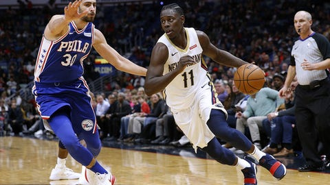 NEW ORLEANS, LA - DECEMBER 10: Jrue Holiday #11 of the New Orleans Pelicans drives against Furkan Korkmaz #30 of the Philadelphia 76ers during the second half of a game at the Smoothie King Center on December 10, 2017 in New Orleans, Louisiana. NOTE TO USER: User expressly acknowledges and agrees that, by downloading and or using this Photograph, user is consenting to the terms and conditions of the Getty Images License Agreement. (Photo by Jonathan Bachman/Getty Images)