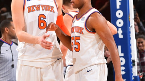 NEW YORK, NY - DECEMBER 10: Kristaps Porzingis #6 and Jarrett Jack #55 of the New York Knicks gather after the win against the Atlanta Hawks at Madison Square Garden on December 10, 2017 in New York, New York NOTE TO USER: User expressly acknowledges and agrees that, by downloading and/or using this Photograph, user is consenting to the terms and conditions of the Getty Images License Agreement. Mandatory Copyright Notice: Copyright 2017 NBAE (Photo by Jesse D. Garrabrant/NBAE via Getty Images)