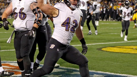 Baltimore Ravens fullback Patrick Ricard (42) celebrates his touchdown during the second half of an NFL football game against the Pittsburgh Steelers in Pittsburgh, Sunday, Dec. 10, 2017. (AP Photo/Keith Srakocic)