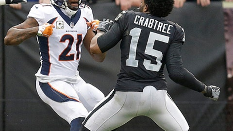 FILE - In this Nov. 26, 2017, file photo, Denver Broncos cornerback Aqib Talib (21) fights Oakland Raiders wide receiver Michael Crabtree (15) during the first half of an NFL football game in Oakland, Calif. Sometimes, it seems, conflicts between cornerbacks and wideouts are simply unavoidable.  It is a unique dynamic in NFL games week after week: On play after play, CBs and WRs match up 1-on-1, with plenty of grabbing and shoving and, yes, yapping mixed in. (AP Photo/Ben Margot, File)