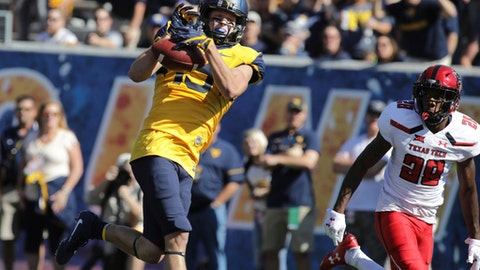 File-This Oct. 14, 2017, file photo shows West Virginia wide receiver David Sills V (13) during an NCAA college football game, in Morgantown, W.Va. Sills was selected to the AP All-America team announced Monday, Dec. 11, 2017. (AP Photo/Raymond Thompson, File)