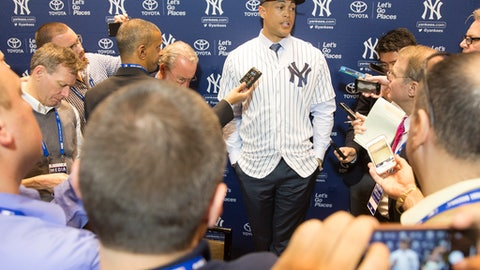 New Yankee Giancarlo Stanton answers questions for the media during the Major League Baseball winter meetings in Orlando, Fla., Monday, Dec. 11, 2017. (AP Photo/Willie J. Allen Jr.)