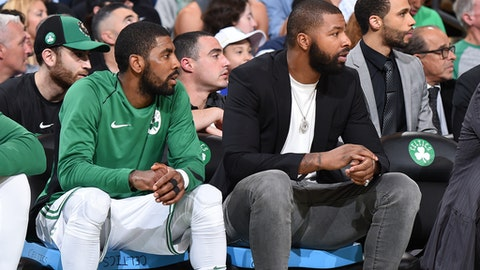 BOSTON, MA - OCTOBER 24: Kyrie Irving #11 and Marcus Morris #13 of the Boston Celtics looks on during the game against the New York Knicks on October 24, 2017 at the TD Garden in Boston, Massachusetts. NOTE TO USER: User expressly acknowledges and agrees that, by downloading and or using this photograph, User is consenting to the terms and conditions of the Getty Images License Agreement. Mandatory Copyright Notice: Copyright 2017 NBAE (Photo by Brian Babineau/NBAE via Getty Images)