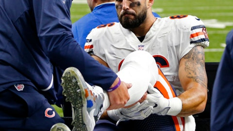 File-This Oct. 29, 2017, file photo shows Chicago Bears tight end Zach Miller (86) being taken off the field on a cart, after injuring his leg in the second half of an NFL football game against the New Orleans Saints in New Orleans.  After eight surgeries and nearly losing his left leg, Miller still refuses to rule out a return to the football field. In his first visit to Halas Hall since his Oct. 29 injury, Miller on Monday, Dec. 11, 2017, expressed thanks for the support he received from the Bears, teammates and fans after vascular surgery to repair a torn artery resulting from a knee injury.  (AP Photo/Butch Dill, File)