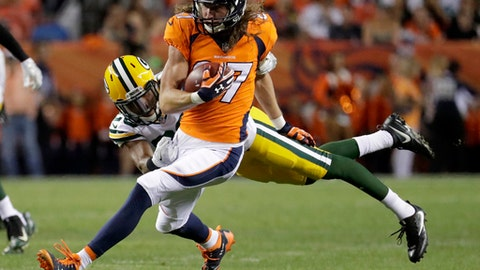 File-This Aug. 26, 2017, file photo shows Denver Broncos wide receiver Jordan Taylor (87) eluding the tackle of Green Bay Packers cornerback Kevin King (20) during the first half of an NFL preseason football game, in Denver.  Named the Denver Broncos' punt returner before the preseason even began, rookie Isaiah McKenzie could hold onto neither the football nor the job. Taylor to the rescue. (AP Photo/Jack Dempsey, File)