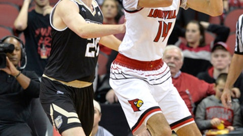 Louisville forward Anas Mahmoud (14) looks for help from the defense of Bryant forward Aram Martin (20) during the first half of an NCAA college basketball game, Monday, Dec. 11, 2017, in Louisville, Ky. (AP Photo/Timothy D. Easley)