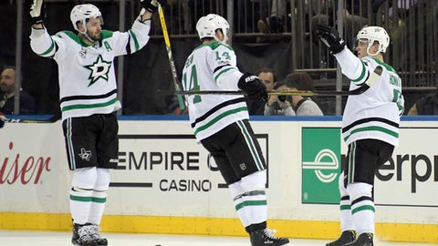 Dallas Stars defenseman Julius Honka, right, celebrates his goal with Jamie Benn (14) and Alexander Radulov, left, during the second period of an NHL hockey game Monday, Dec. 11, 2017, at Madison Square Garden in New York. (AP Photo/Bill Kostroun)