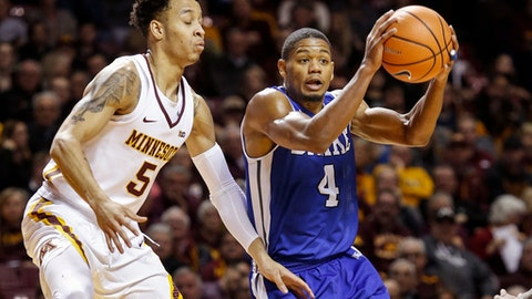 Drake guard De'Antae McMurray (4) looks to pass around Minnesota guard Amir Coffey (5) in the first half of an NCAA college basketball game Monday, Dec. 11, 2017, in Minneapolis. (AP Photo/Bruce Kluckhohn)