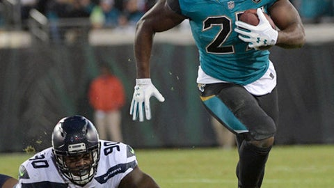 FILE - In this Dec. 10, 2017, file photo, Jacksonville Jaguars running back Leonard Fournette (27) runs past Seattle Seahawks defensive tackle Jarran Reed (90) for a gain during the second half of an NFL football game, in Jacksonville, Fla. The last time the Jacksonville Jaguars were alone atop the AFC South this late in a season, they lost three straight and missed the playoffs. (AP Photo/Phelan M. Ebenhack, File)
