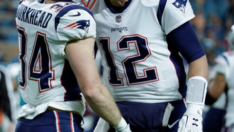 New England Patriots quarterback Tom Brady (12) congratulates running back Rex Burkhead (34) after Bulkhead scored a touchdown, during the first half of an NFL football game against the Miami Dolphins, Monday, Dec. 11, 2017, in Miami Gardens, Fla. (AP Photo/Lynne Sladky)