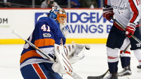 New York Islanders goalie Jaroslav Halak (41), of Slovakia, makes a save as Washington Capitals center Nicklas Backstrom (19), of Sweden, watches during the third period of an NHL hockey game in New York, Monday, Dec. 11, 2017. (AP Photo/Kathy Willens)
