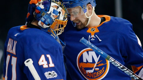 New York Islanders Calvin de Haan (44) congratulates goalie Jaroslav Halak (41), of Slovakia, after they defeated the Washington Capitals in an NHL hockey game in New York, Monday, Dec. 11, 2017. (AP Photo/Kathy Willens)