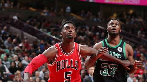 CHICAGO, IL - DECEMBER 11:  Bobby Portis #5 of the Chicago Bulls and Semi Ojeleye #37 of the Boston Celtics await the ball during the game on December 11, 2017 at the United Center in Chicago, Illinois. NOTE TO USER: User expressly acknowledges and agrees that, by downloading and or using this Photograph, user is consenting to the terms and conditions of the Getty Images License Agreement. Mandatory Copyright Notice: Copyright 2017 NBAE (Photo by Gary Dineen/NBAE via Getty Images)